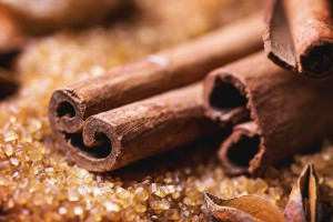 Spices cinnamon over heap of brown sugar. See series